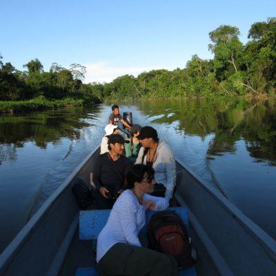 CUYABENO JUNGLE TOUR Surroundings - Canoe with people back - Ecuador & Galapagos Tours
