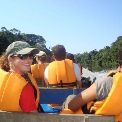 CUYABENO JUNGLE TOUR Surroundings - Canoe with people front - Ecuador & Galapagos Tours