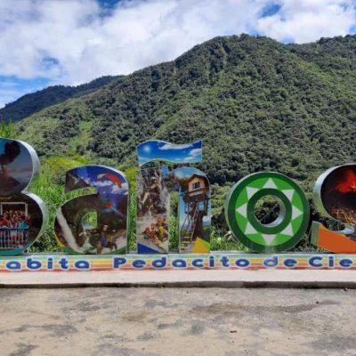 WHY BAÑOS A MUST VISIT IS WHEN TRAVELING TO ECUADOR Baños-de-agua-santa-big-letters-mountains-adoreecuador - Ecuador & Galapagos Tours